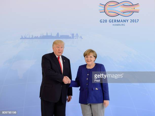 German Chancellor Angela Merkel receives US President Donald Trump in the Hotel Atlantic on the eve of the G20 summit for bilateral talks on July 6...