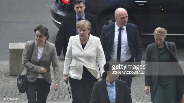 German Chancellor Angela Merkel returns to the Bundestag after the hand over ceremony of the certificate of appointment in Berlin on March 14 links...