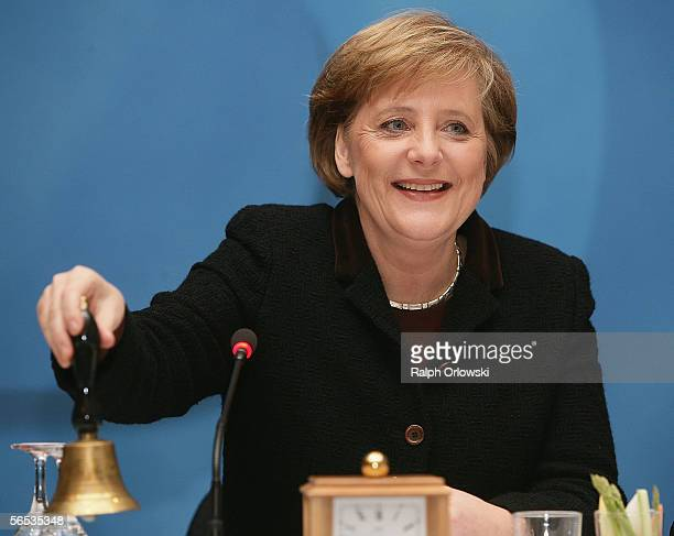 German Chancellor Angela Merkel rings a bell at the beginning of a leadership conference of the Christian Democratic Union of RhinelandPalatinate...
