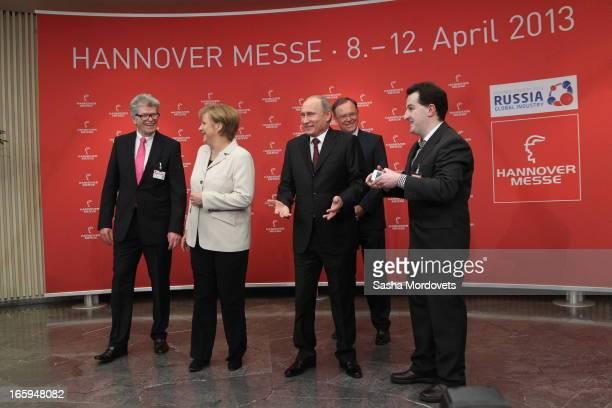 German Chancellor Angela Merkel Russian President Vladimir Putin and Ukraine's born journalist of LeineHertz 1065 radio station Dimitri Schilmover...