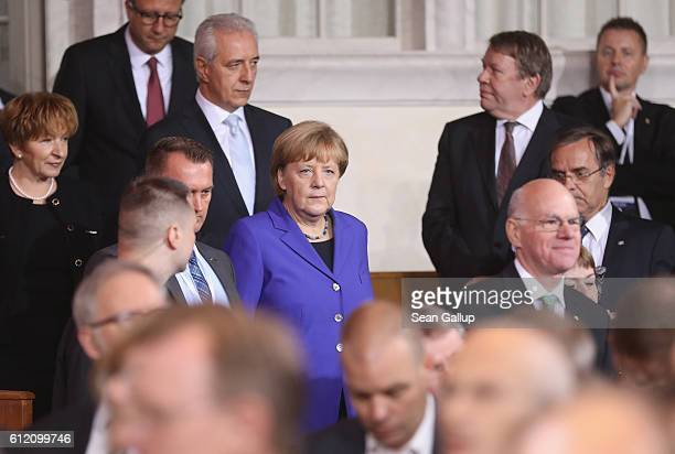 German Chancellor Angela Merkel Saxony Governor Stanislaw Tillich and Bundestag President Norbert Lammert arrive for a commemoratory service at the...
