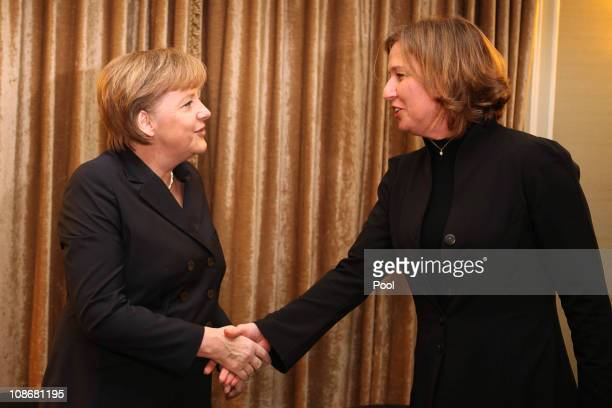 German Chancellor Angela Merkel shakes hand with Israeli opposition leader Tzipi Livni at the start of their meeting on February 01 2011 in Jerusalem...