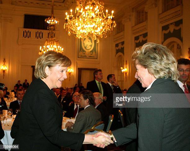 German Chancellor Angela Merkel shakes hands with Angelika Jahr during the 12th Hamburg Media Dinner at Hotel Atlantic on February 22 2007 in Hamburg...