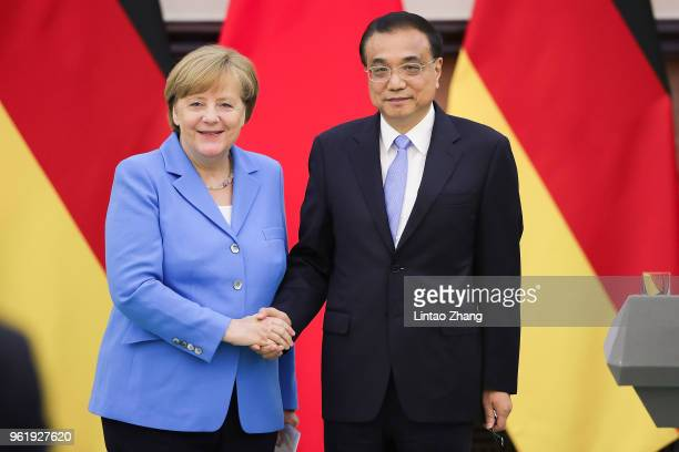 German Chancellor Angela Merkel shakes hands with China's Premier Li Keqiang during a joint news conference at the Great Hall of the People on May...