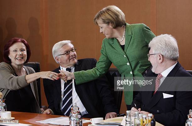 German Chancellor Angela Merkel shakes hands with German Development Minister Heidemarie Wieczorek-Zeul as German Foreign Minister Frank-Walter...