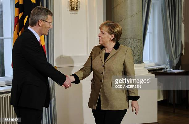 German Chancellor Angela Merkel shakes hands with German President Christian Wulff during a new year's reception on January 12, 2012 at Bellevue...