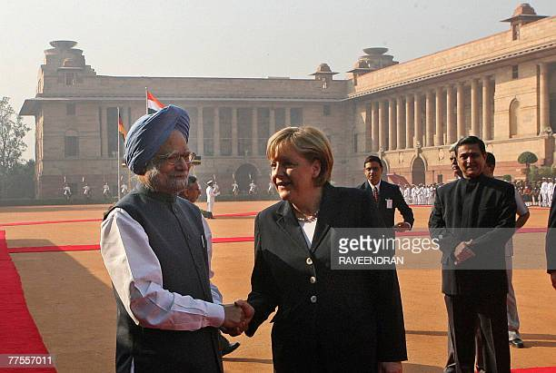 German Chancellor Angela Merkel shakes hands with Indian Prime Minister Manmohan Singh at the Presidential palace in New Delhi 30 October 2007....