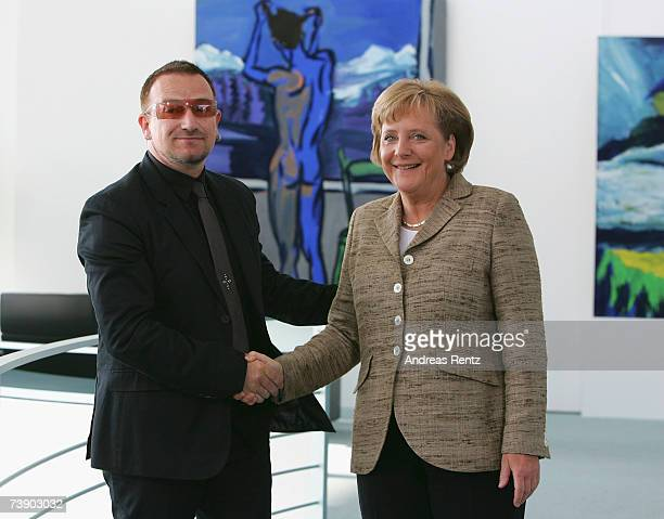 German Chancellor Angela Merkel shakes hands with Irish rock singer Bono at the chancellor's office, on April 17, 2007 in Berlin, Germany. Merkel is...