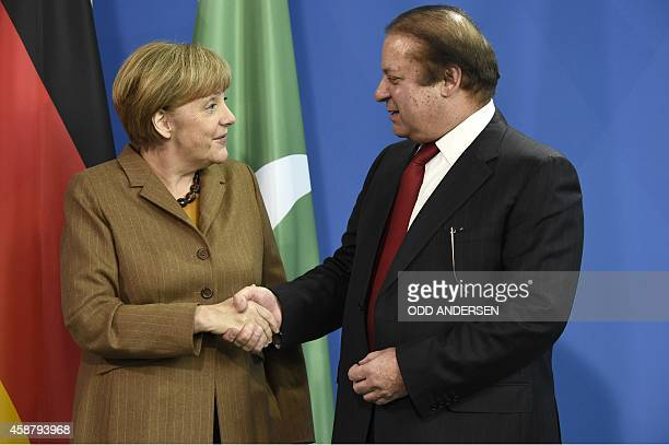 German Chancellor Angela Merkel shakes hands with Pakistani Prime Minister Nawaz Sharif after their joint press conference following their meeting at...