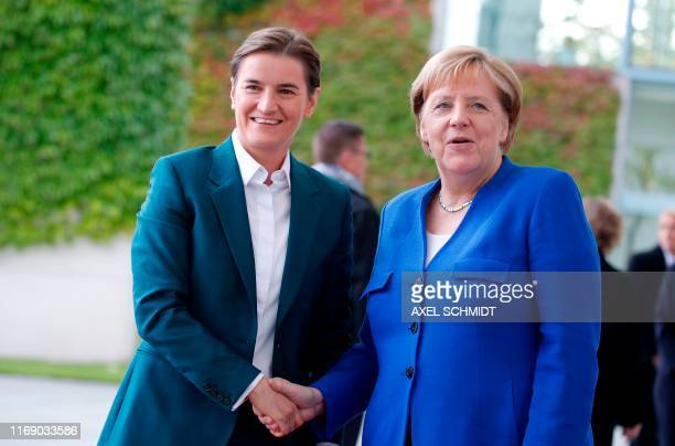 German Chancellor Angela Merkel shakes hands with Serbian Prime Minister Ana Brnabic as she welcomes her in front of the Chancellery in Berlin on...