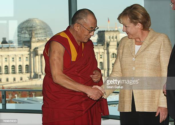 German Chancellor Angela Merkel shakes hands with the Dalai Lama after private talks at the Chancellery September 23 2007 in Berlin Germany China has...