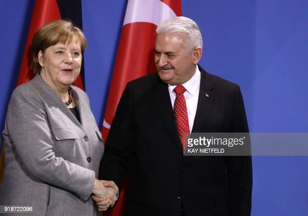 German Chancellor Angela Merkel shakes hands with Turkish Prime Minister Binali Yildirim after a press conference on February 15, 2018 at the...