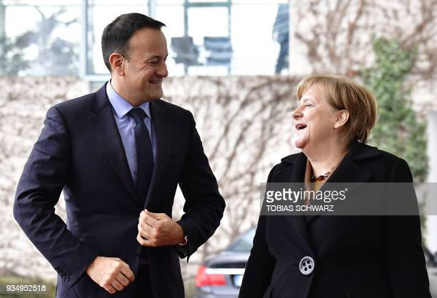 German Chancellor Angela Merkel shares a smile with Irish Prime Minister Leo Varadkar as she welcomes him for talks in Berlin on March 20 2018 / AFP...