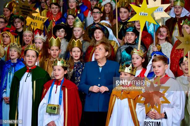 German Chancellor Angela Merkel sings with Carol Singers from across the country during a reception at the Chancellery in Berlin on January 7 2019...