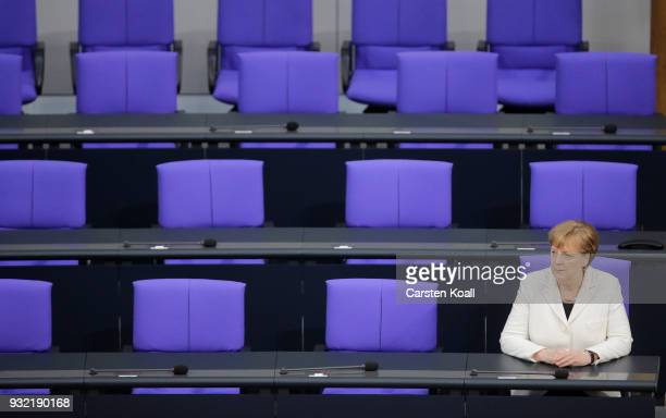 German Chancellor Angela Merkel sits down after taking her oath to serve her fourth term as chancellor following her election by the Bundestag on...