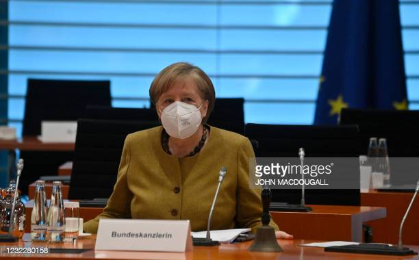 German Chancellor Angela Merkel sits down for the weekly cabinet meeting on April 13, 2021 at the Chancellery in Berlin.