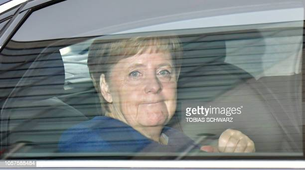 German Chancellor Angela Merkel sits in a car as she arrives for the continuation of a meeting with her conservative Christian Democratic Union...