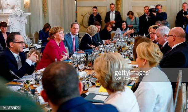 German Chancellor Angela Merkel sits next to German Foreign Minister Heiko Maas and among members of the government ahead of a cabinet meeting on...
