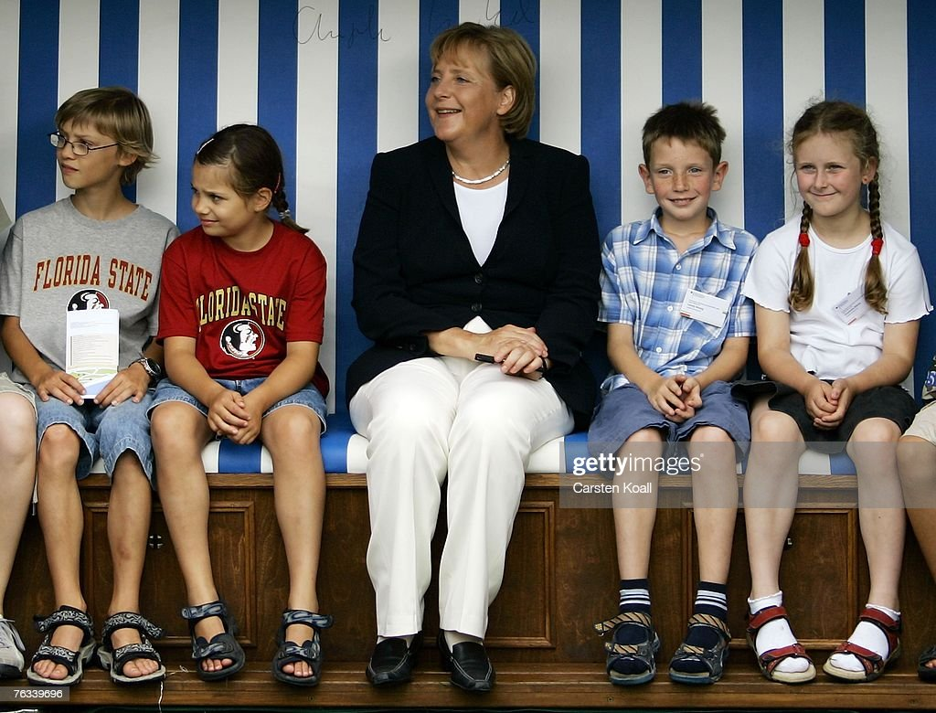 German Chancellor Angela Merkel Sits Together With Kids At A Beach News Photo Getty Images