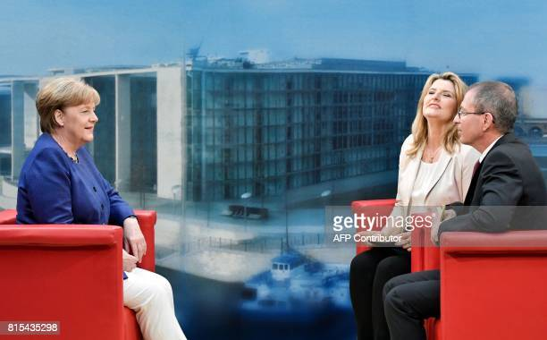 German Chancellor Angela Merkel sits with with journalists Tina Hassel and Thomas Baumann before the recording of the traditional summer interview...