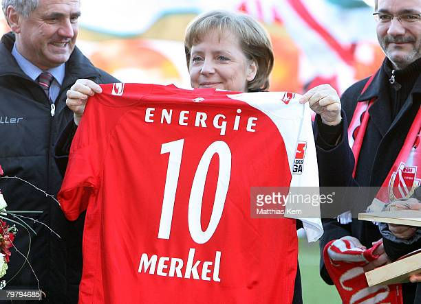German Chancellor Angela Merkel smiles after getting the honorary membership of the German football club FC Energie Cottbus prior to the Bundesliga...