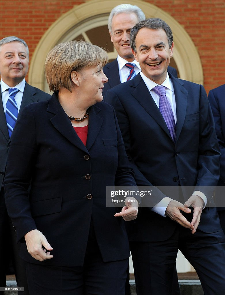 German Chancellor Angela Merkel (L) smiles as she changes sides with Spain's Prime Minister Jose Luis Rodriguez Zapatero as they pose for a family photo at La Moncloa Palace on February 3, 2011 in Madrid, Spain. Merkel is visiting Spain with her finance and economy ministers for a one day official visit.
