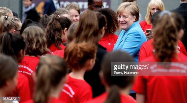 German Chancellor Angela Merkel smiles during her visit at a program to encourage integration of children with foreign roots through football at the...