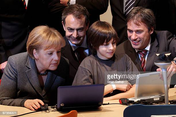 German Chancellor Angela Merkel Spanish Prime Minister Jose Luis Rodriguez Zapatero and Microsoft Germany head Achim Berg ges instruction from...