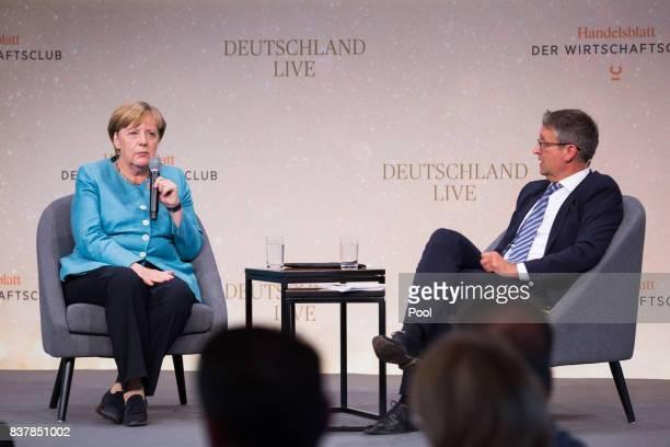German Chancellor Angela Merkel speaks alongside Handelsblatt editor Gabor Steingart during Germany Live Where does the West go at the Westhafen...