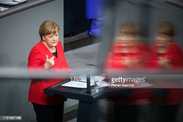 German Chancellor Angela Merkel speaks at the government declaration about the European Council during the meeting of the German Parliament on March...