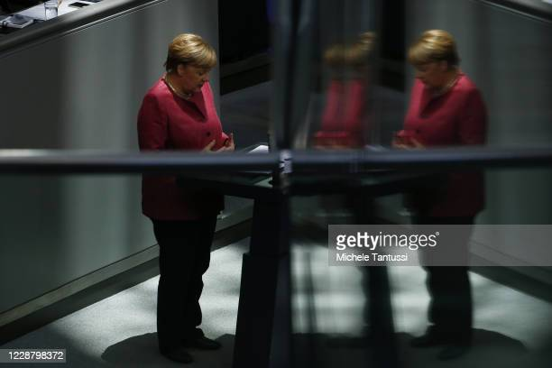 German Chancellor Angela Merkel speaks at the plenary room of the German lower house of Parliament or Bundestag during the debate on budget law on...