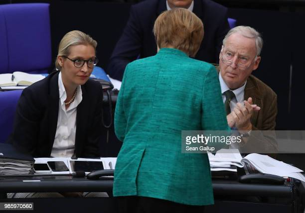 German Chancellor Angela Merkel speaks briefly with Alice Weidel and Alexander Gauland of the rightwing Alternative for Germany political party after...