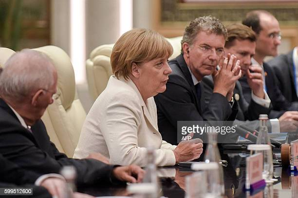 German Chancellor Angela Merkel speaks during a bilateral meeting with Chinese President Xi Jinping at their meeting at the West Lake State House in...