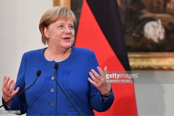 German Chancellor Angela Merkel speaks during a joint press conference with Italy's Prime Minister within their meeting at Villa Pamphili in Rome on...