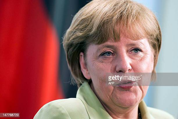 German Chancellor Angela Merkel speaks during a joint press conference with Slovak Prime Minister at the Chancellory July 03, 2012 in Berlin. Merkel...