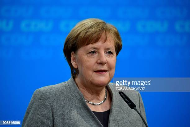 German chancellor Angela Merkel speaks during a press conference at the headquarters of her Christian Democratic Party in Berlin on January 21 2018...
