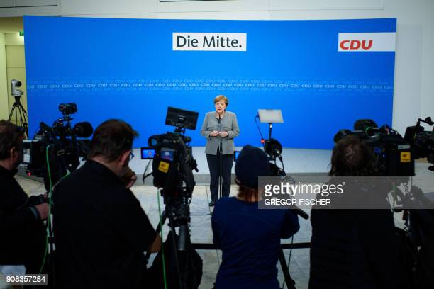 TOPSHOT German chancellor Angela Merkel speaks during a press conference at the headquarters of her Christian Democratic Party in Berlin on January...