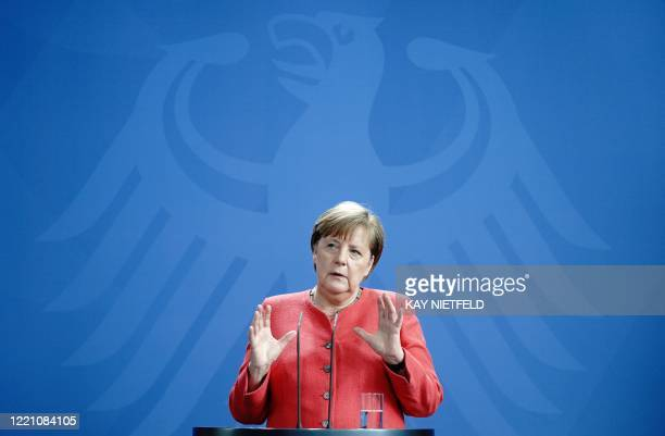 German Chancellor Angela Merkel speaks during a press conference on June 19 2020 in Berlin after a video conference with members of the European...