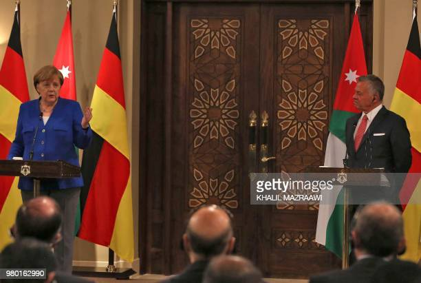 German Chancellor Angela Merkel speaks during a press conference with Jordan's King Abdullah II at the Royal Palace in the Jordanian capital Amman on...