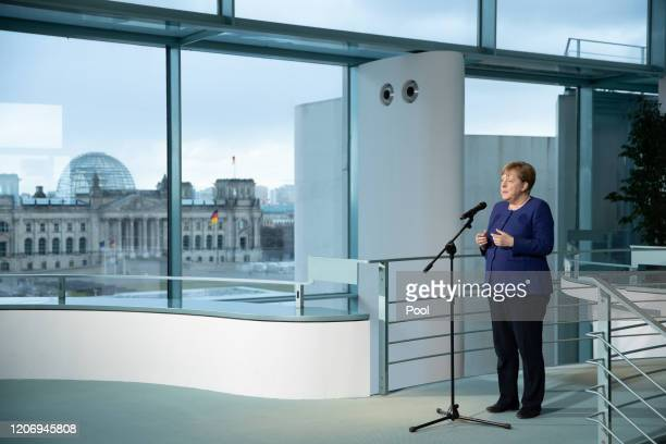 German Chancellor Angela Merkel speaks during a press statement prior to meeting with economic and labor unions leaders at the Chancellery on March...