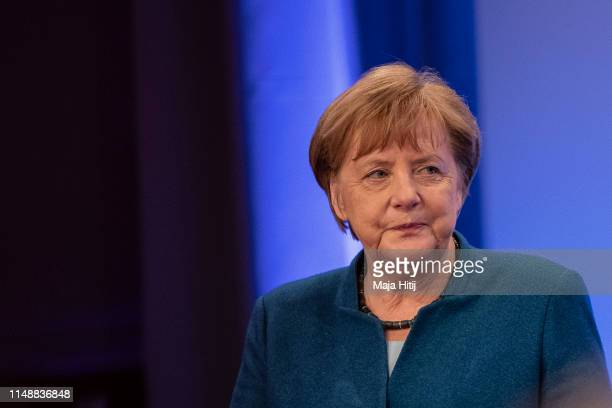 German Chancellor Angela Merkel speaks during a town-hall style meeting with locals to discuss Germany's constitution on May 13, 2019 in Wuppertal,...