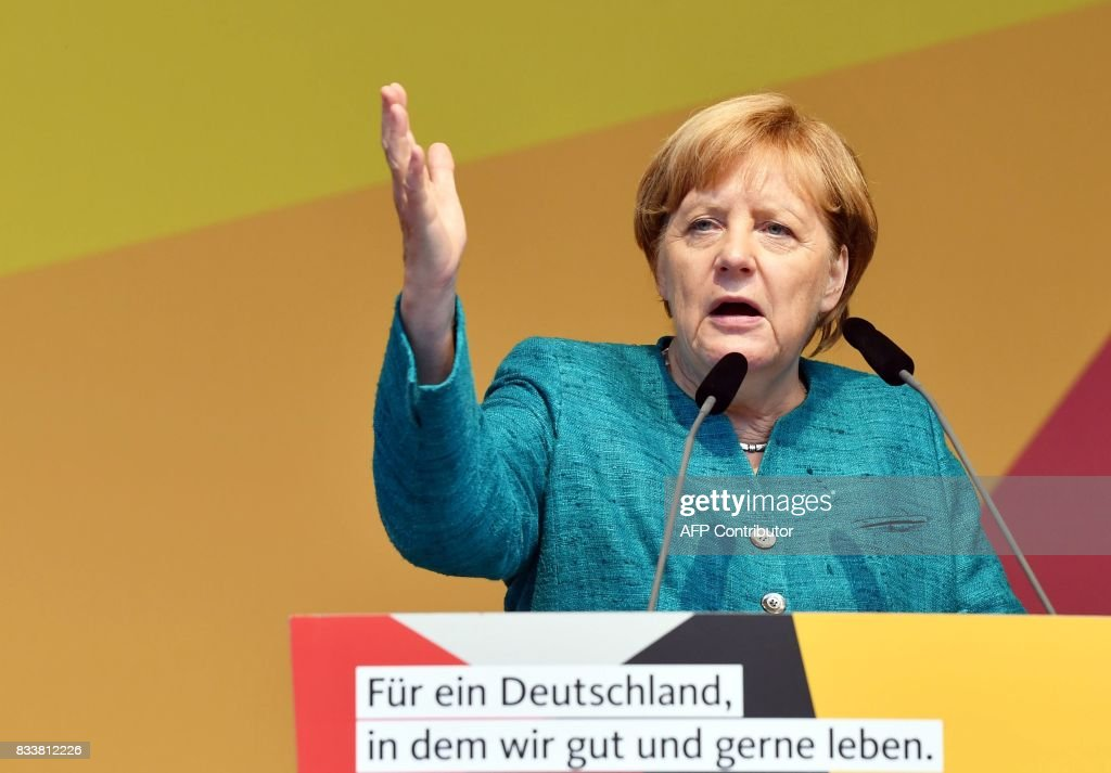 German Chancellor Angela Merkel speaks during her party electoral meeting on August 17, 2017 in Annaberg-Buchholz. The office of German Chancellor Angela Merkel on Thursday condemned the 'revolting attack' in Barcelona, in which a van ploughed through a street packed with pedestrians, killing 13 people. / AFP PHOTO / dpa / Jens Kalaene / Germany OUT