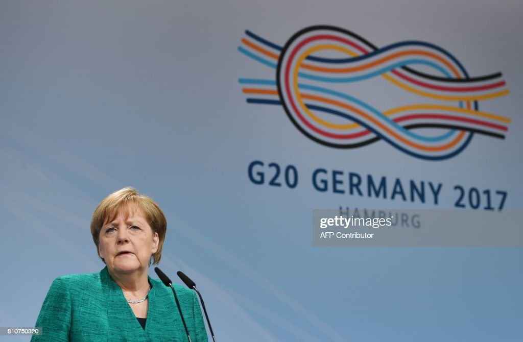 German Chancellor Angela Merkel speaks during the final press conference on the second day of the G20 Summit in Hamburg, Germany, July 8, 2017. Leaders of the world's top economies gather from July 7 to 8, 2017 in Germany for likely the stormiest G20 summit in years, with disagreements ranging from wars to climate change and global trade. / AFP PHOTO / Patrik STOLLARZ