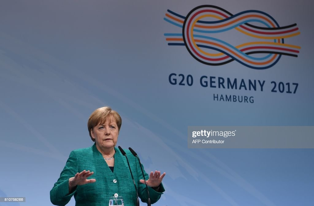 German Chancellor Angela Merkel speaks during the final press conference on the second day of the G20 Summit in Hamburg, Germany, July 8, 2017. Leaders of the world's top economies gather from July 7 to 8, 2017 in Germany for likely the stormiest G20 summit in years, with disagreements ranging from wars to climate change and global trade. /