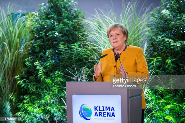 "German Chancellor Angela Merkel speaks during the opening of the ""Klima Arena,"" or Climate Arena, on October 7, 2019 in Sinsheim, Germany. The..."