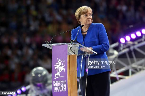 German Chancellor Angela Merkel speaks during the Stadium Gala of the 2017 Deutsches Turnfest at the Olympic Stadium in Berlin on June 6 2017 / AFP...