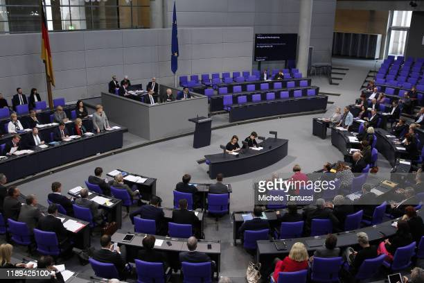 German Chancellor Angela Merkel speaks on behalf of the federal government during a one-hour question and answer session by parliamentarians at the...