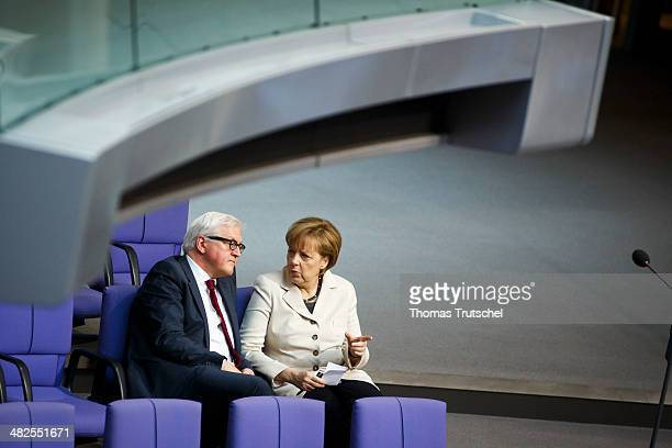 German Chancellor Angela Merkel speaks to German Foreign Minister FrankWalter Steinmeier at Bundestag the German federal Parliament on April 04 2014...