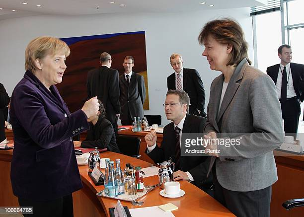 German Chancellor Angela Merkel speaks to her personal assistant Beate Baumann prior to the weekly German government cabinet meeting at the...
