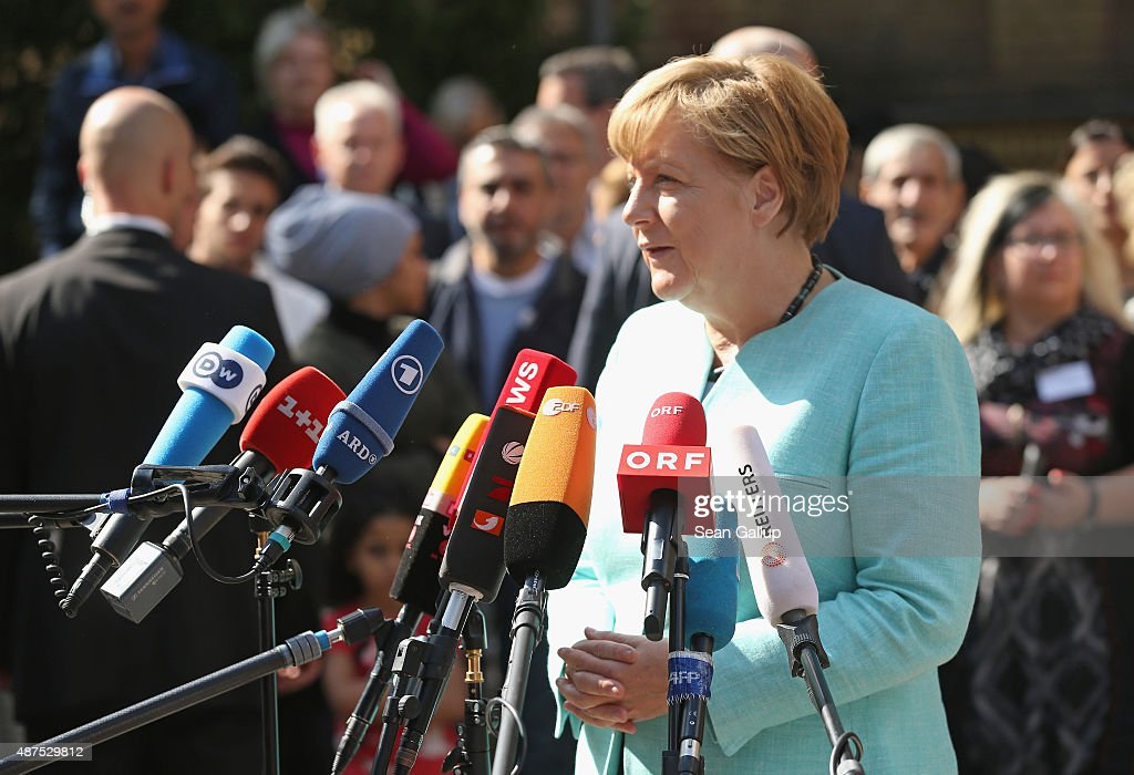 German Chancellor Angela Merkel speaks to the media after she visited the AWO Refugium Askanierring shelter for migrants on September 10, 2015 in Berlin, Germany. Merkel visited several facilities for migrants today, including an application center for asylum-seekers, a school with welcome classes for migrant children and a migrant shelter. Thousands of migrants are currently arriving in Germany every day, most of them via the Balkans and Austria. Germany is expecting to receive 800,000 asylum applicants this year.